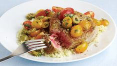 Pan-Seared Tuna Steaks with Warm Tomato, Basil, and Olive Salad - Recipe - FineCooking