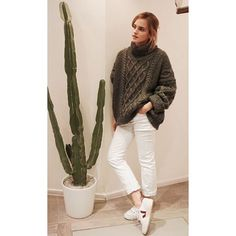 Emma Watson: Emma wearing a cable sweater with a pair of trainers