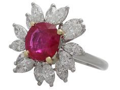 'Vintage Ruby and Diamond Ring in Platinum - French' http://www.acsilver.co.uk/shop/pc/2-30-ct-Ruby-and-1-85-ct-Diamond-Platinum-Cluster-Ring-Vintage-French-Circa-1960-176p7388.htm