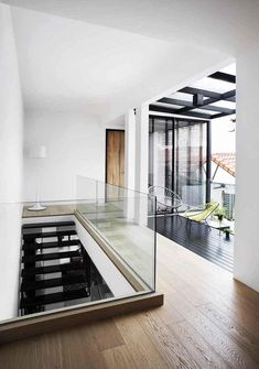 House Tour: Open-plan design and statement furniture in this semi-detached house - Home & Decor Singapore Semi Detached, Detached House, Staircase Railings, Oak Dining Table, Plan Design, Image House, Open Plan, White Walls, House Tours