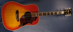 1968 Gibson Hummingbird acoustic guitar with its typical cherry Sunburst finish.