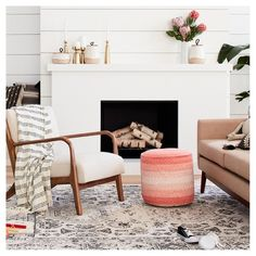 """• Made of 100% cotton with a polystyrene bead fill<br>• Measures 15""""x20""""x20""""<br>• Weighs 4.8 pounds<br><br>A quick extra seat or place to rest your feet, the Braided Pouf in Peach Cheek from Pillowfort is a smart addition to your home. This fabric pouf comes in a pastel hue that will warm your home."""