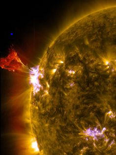The Sun had a bit of a hissy fit on May 3, 2013. See that blue dot above the prominence? Thats about how big the Earth is. Click to enhelionate.