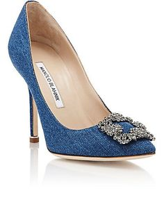 """Manolo Blahnik Hangisi Pumps  blue denim Hangisi pumps embellished at vamp with crystal-encrusted square buckle.       4""""/105mm heel (approximately)     Pointed toe, denim-covered stiletto heel, circular top piece     Slips on    $965"""