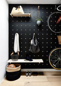 black-painted pegboard for the entryway
