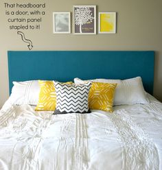 Door used as a headboard...She used a curtain panel to cover it!