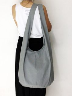 Handmade Canvas Bag Shoulder bag Sling bag Hobo bag Messenger Crossbody Purse - Gray. $11.99, via Etsy.