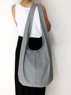 Handmade Canvas Bag Shoulder bag Sling bag Hobo bag Messenger Crossbody Purse - Gray. $11.99, via Etsy.