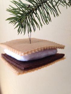I love Smores and summer is coming! I have machine embroidered and assembled all of the components to make a perfect felt smore! Hang it in your holiday tree or anywhere you can think of! Each smore i
