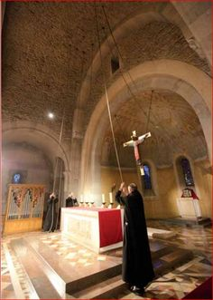 Monks ring bells for call to Evening Prayer at Benedictine Abbey at Le Barroux, France