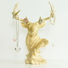 KATIE/BELLA: A stag bust whose crowning glories are beautiful pieces of jewelry. | 29 Gifts That Will Trick People Into Thinking You're Fancy