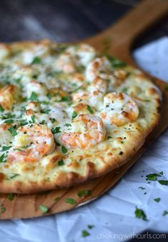 Shrimp Scampi Pizza topped with a light garlic-lemon sauce, shrimp, and cheeses.