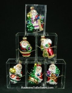 Sold only as a complete set of 6 ornaments - assorted Santas with trees, trains, toybags and accented with glitter. Individually packed in acrylic boxes you can accomplish Santa Ornaments, Stuffing, Snow Globes, Trains, Hand Carved, Boxes, Carving, Glitter, Glass