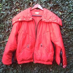 Authentic CHANEL Ski Jacket Fabulous 90's red ski jacket with all the luxe details expected from CHANEL. Dramatic oversized collar with classic interlocking c's snaps. Chanel logo on leather pull tabs ( unfortunately the one for the main center zip is missing but could easily thread a piece of black ribbon through it. In great condition except for the area near the bottom of the jacket arms where there are rips. Could be shortened to remove it. A great piece emblematic of ski chic in the…
