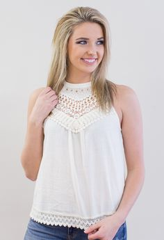 """This halter style tank will add the perfect touch of femininity to your closet with its embroidered details. 100% Cotton Model is 5'9"""" and size 6 in a Small. Measurements Length Bust Small 24"""" 38"""" Med"""