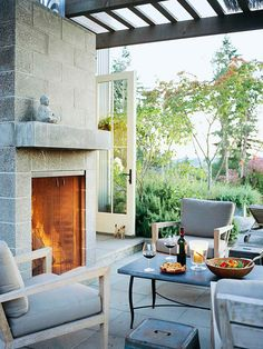 Outside fireplace can be made from cinder block and still look chic? Maybe paint the cinder blocks. Is this cinder block?  Build to Rumford outdoor fireplace specs and plans.