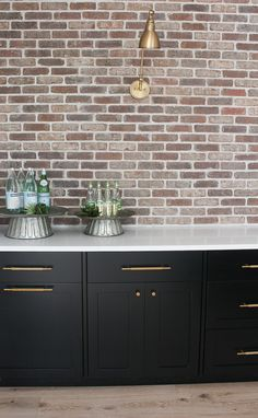 industrial modern bar with brick wall black cabinets Brick Wall Kitchen, Black Kitchen Cabinets, Basement Kitchen, Basement Walls, Black Kitchens, Basement Bathroom, Brick Bathroom, Bathroom Plumbing, Black Brick Wall