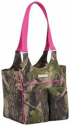 This mini-carryall by Ariat is the perfect bag for an afternoon adventure!  Designed in a whimsical camo print with hot pink accents, Ariat's mini-carryall bag holds everything you need. It is constructed with durable poly canvas and features webbing handles, multiple internal compartments, zippered pockets, and even sports pockets with an elasticized strap to hold your water bottle.   http://www.tackroominc.com/ariat-mini-carry-all-bag-pinkcamo-p-17475.html