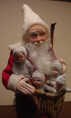 Do you like Snow Babies?  So do I, Santa has a basket full.  Pretty little guys, don't you think? (decamp)