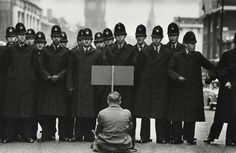 Don McCullin -A lone anti-war protester confronts police in Whitehall during the Cuban Missile Crisis, London, 1962