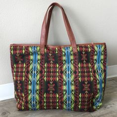 "Multi-Color Tribal Tote Faux leather, fully lined. Length: 22"" Width: 16"" Bags"