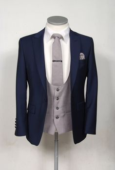 navy blue mohair grooms wedding suit with Grey scoop waistcoat.
