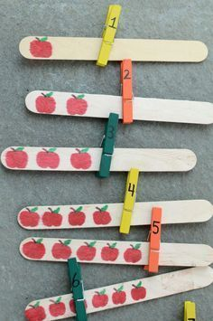 Great back to school math center. Quick and easy DIY project that not only works on 1:1 correspondence, but also fine motor skills.  Get the directions at:  http://www.pleasantestthing.com/apple-counting-activity