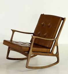 Anonymous; Wood and Skai Rocking Chair by Anonima Castelli, 1960s.