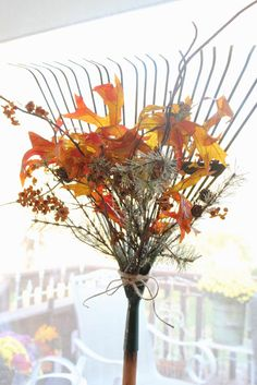 Great way to repurpose an old rake.  Can decorate it for Christmas with greens and berries.