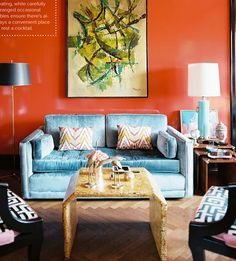 love the orange wall & blue couch.
