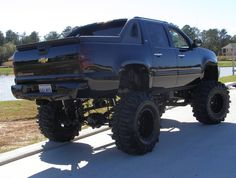 Lifted Chevy Avalanche truck.