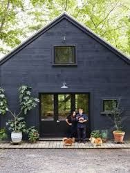 Black And Gray Exterior House In Lakeside Blue Exterior House Black Exterior Doors Black Facade Black Garage