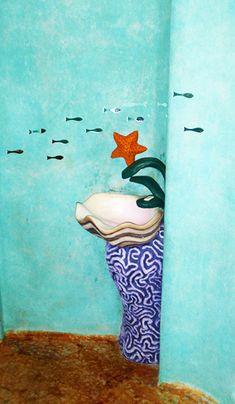Lavamanos Concha sobre un coral con grifo en forma de algas y llave con forma de estrella todo de cemento