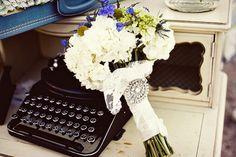 bouquet, brooch, typewriter