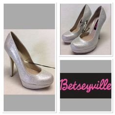 "Betseyville rhinestone heels NWOT size 6 Beautiful rhinestone encrusted pumps but Betsey Johnson's line Betseyville. White pumps  completely covered in rhinestones, rounded toe, 5"" heel and 1"" platform, textile upper and textile and manmade outsold. This pair is new never worn. Have slight greenish stain to one heel as pictured, and small pink smudge on left inseam from being tried on in the store but it's not noticeable. My camera couldn't even pick up the pink smudge. Betsey Johnson Shoes…"