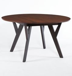 the elegance dining table is a round extendable table with legs in
