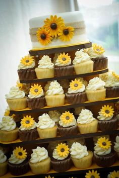 Like the idea of cupcakes...easier to serve. Make them two different colors instead of having the sunflowers on them.