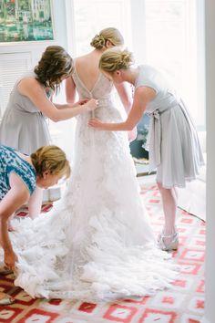 a stunning Lazaro gown full of lace and ruffles Photography: M Three Studio - mthreestudio.com  Read More: http://www.stylemepretty.com/2014/06/05/lakeside-al-fresco-wedding/