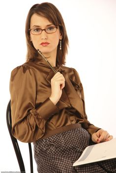 """arrogantmistress: """" Leggy Ladies a must for slaves and leglovers….go to forum! LeggyLadies at Xlegs.net """" The look of a very strict Christian Governess ready to give a very naughty boy a very severe bare bottom spanking!"""