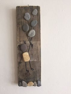 A chance to is a piece of unique pebble art, made with driftwood, and pebbles from the shores of the Yorkshire coast.  Let your imagination run wild with thoughts of where your up and away adventure may take you.  This piece has a small brass hook for hanging on the wall.