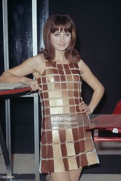 French actress Genevieve Thenier wears a dress composed of small metallic rectangles linked together with wire loops created by French fashion designer Paco Rabanne in French Fashion Designers, French Actress, Paco Rabanne, Twiggy, Fashion Beauty, Actresses, Third Rail, How To Wear, 1960s