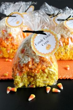 Candy Corn CORN - Marshmallow popcorn colored & shaped like candy corn with bits of candy corn candies throughout from DessertNowDinnerLater.com FREE printable tags included. #halloween