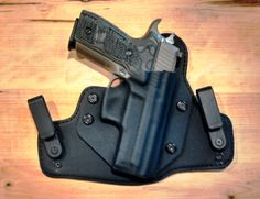 My SIG Sauer P229 Scorpion 9mm in my Alien Gear Cloak Tuck 2.0 IWB Holster Find our speedloader now! http://www.amazon.com/shops/raeind