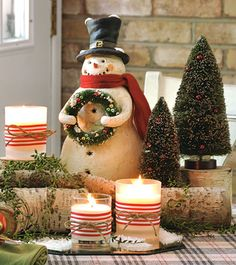 A darling snowman and birch log vignette with candles!!! Bebe'!!! Really cute for a New England holiday Tablescape or for anyone with children!!!