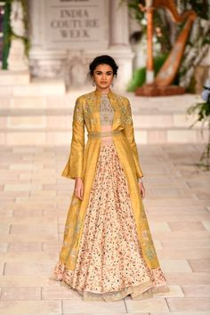 Latest Bride Sister Lehenga Designs. Mustard yellow jacket lehenga with floral skirt by Anju Modi. #Frugal2Fab