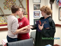 Natalia Truszczynski, left, and K.T. White, middle, kissed after being married by Fayette Circuit Judge Kathy Stein in her chambers in Judge Stein's chambers in Lexington, Ky., Friday, June 26, 2015.