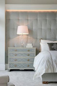 Master bedroom with tufted headboard wall. Spacecrafting Photography.