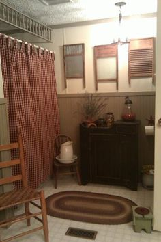 Country bathroom.  It could be cute to put hooks on the washboards to use as towel holders.