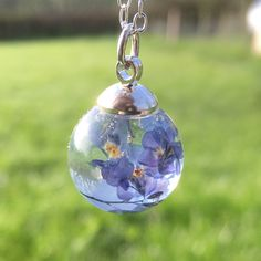One of my originals and favourites is this beautiful forget me not orb necklace they look gorgeous with the sun shinning through them