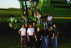 Submitted photo  	The Wagner family in their John Deere green.  Standing left to right Mary, Wendall, Melanie, Michael, Geraldine, Andrew, Brittany and Matt; on the combine left to right Marshall, Mitchell, Madeline, Tina and MacKenzie.